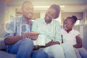 Pretty couple offer a present for their daughter