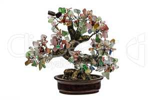 Decorative tree from natural semiprecious stones isolated on whi
