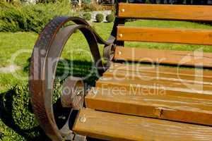Forged metal armrests with wooden park bench