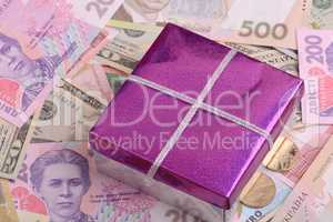american money and red gift box, european money