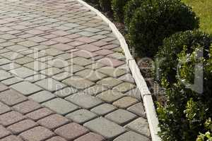 Garden paths of colored decorative bricks