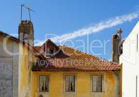 An old house in Sintra, Portugal, with tile roof and garret