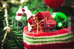 Christmas sock with toys and gifts on wooden background with Christmas tree