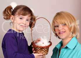 mother and daughter with cute dwarf rabbit