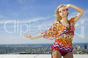 beautiful girl in colored blouseon background blue sky