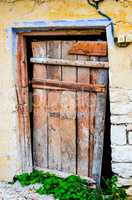 Weathered red door in a village