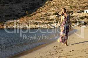 beautiful brunette woman in romantic summer dress