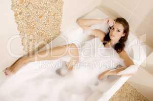 Woman in bath relaxing. Closeup of young woman in bathtub bathin