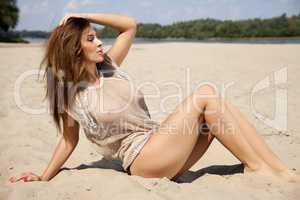 beautiful brunette woman in brown transparent sweater