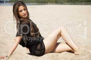 beautiful brunette woman in black transparent blouse