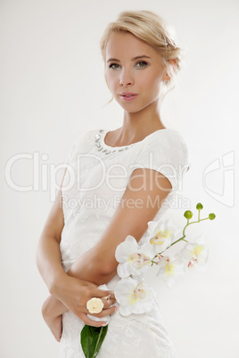 Young bride in white wedding dress happy smiling