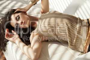 Beautiful and attractive female woman posing in golden brown swe