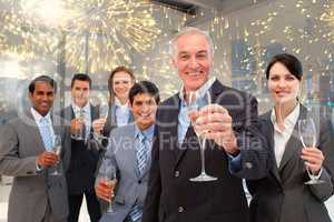Composite image of happy diverse business group toasting with ch