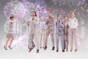 Composite image of very happy business people jumping and clench