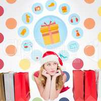 Composite image of thoughtful woman lying between shopping bags