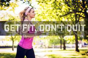 Composite image of fit blonde jogging in the park
