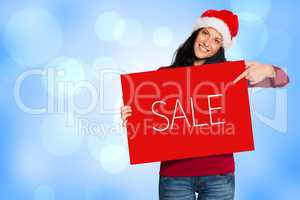 Composite image of woman holding a white sign