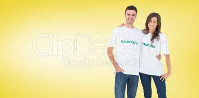 Composite image of two cheerful people wearing volunteer tshirt