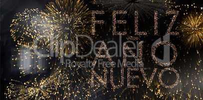 Composite image of glittering feliz ano nuevo