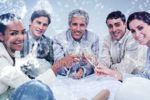 Composite image of smiling architectutal team celebrating a succ