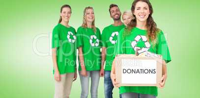 Composite image of people in recycling symbol tshirts with donat