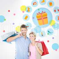 Composite image of attractive young couple holding shopping bags