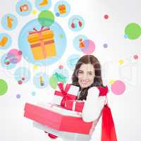 Composite image of joyful brunette holding christmas gifts and s