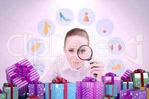 Composite image of businesswoman typing and looking through magn