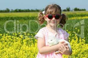 little girl holding white dwarf bunny