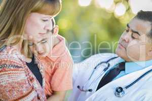 Sick Mixed Race Boy, Mother and Hispanic Doctor Outdoors
