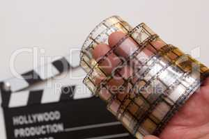 Old film strip in the man's hand