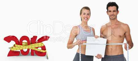 Composite image of sporty couple holding scales and measuring ta