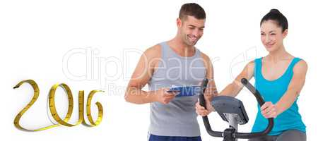 Composite image of trainer with client on exercise bike