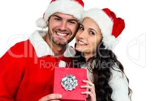 Festive couple smiling at camera