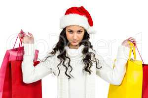 Woman with christmas hat holding colored shopping bags
