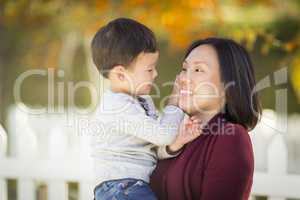 Chinese Mom Having Fun and Holding Her Mixed Race Boy