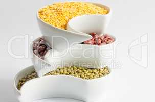 Multicolored beans in white ceramics bowl