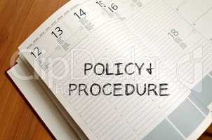 Policy and procedure write on notebook