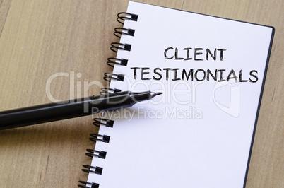 Client testimonials write on notebook