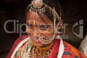 Traditional Indian female in sari smiling