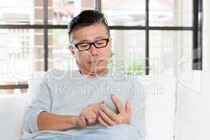 Mature Asian man using smartphone