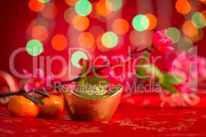 Chinese New Year decorations gold ingots on red background
