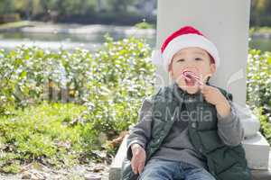 Cute Mixed Race Boy With Santa Hat and Candy Cane