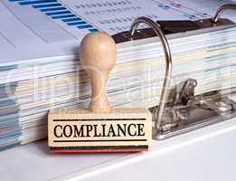 Compliance - rubber stamp in the office