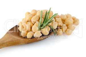 Chickpeas over wooden spoon