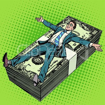 Business financial success concept businessman at the stack of money