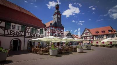 Timelapse of a little german marketplace with church in summer