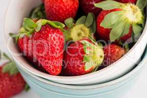 Bowls with strawberries