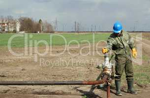 oil worker open pipeline valve