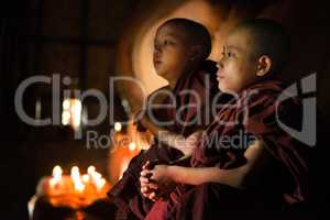 Buddhist novices praying inside temple